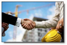 Handshake in front of Commercial Real Estate Building